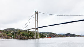 Sotra Bridge. Is a suspension bridge crossing Knarreviksundet in Norway connecting Fjell and Bergen.  The city of Bergen can be seen in the background Royalty Free Stock Photo