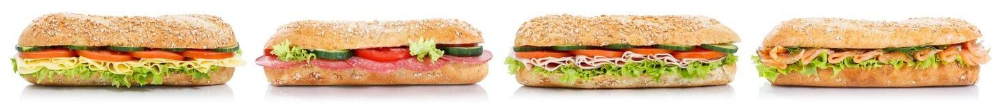 Sotto panini con il pesce di color salmone del formaggio del prosciutto del salame in un isola di fila Fotografia Stock
