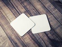 Sottobicchieri quadrati in bianco Fotografie Stock