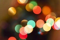 sottragga la priorità bassa Bokeh, punti confusi multicolori Fotografie Stock