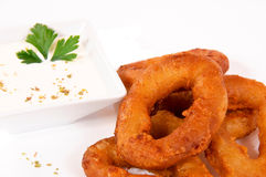 Souce and calamari. White onion souce and calamri royalty free stock image
