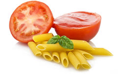 Souce tomatoes. With basil and maccaroni royalty free stock photo