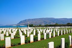 Souda Bay Allied War Cemetery, Crete. View of the Souda Bay Allied War Cemetery with the Aegean sea to the rear, Souda Bay, Crete, Greece, Europe royalty free stock images