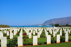 Souda Bay Allied War Cemetery, Crete. View of the Souda Bay Allied War Cemetery with the Aegean sea to the rear, Souda Bay, Crete, Greece, Europe Royalty Free Stock Image
