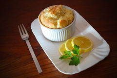 Soufflé with slices of lemons Stock Image