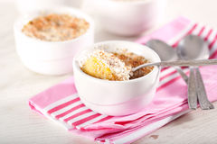 Souffle. Baked pumpkin and coconut souffle in white bowls Royalty Free Stock Photography