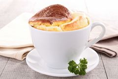 Souffle. Cup with warm souffle cheese Royalty Free Stock Image