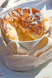 Souffle. Airy refined souffle served as a dessert on the open terrace of an upscale French restaurant Royalty Free Stock Images