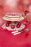 Souffle Cake and Christmas decorations, effeckt bokeh on background. Stock Photos