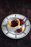 Souffle cake with raspebrries. Sauce,selective focus Royalty Free Stock Image