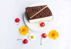 Souffle cakes, cherries and flowers Royalty Free Stock Photography