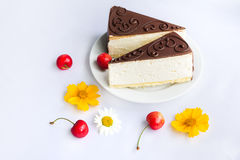 Souffle cakes, cherries and flowers Royalty Free Stock Photo