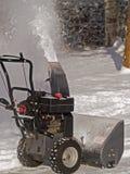 Souffleuse de neige dans l'action Photographie stock