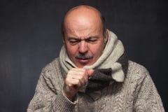 Souffrance du virus de grippe Photographie stock libre de droits