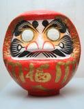 souhait de Japonais de poupée de daruma Photographie stock