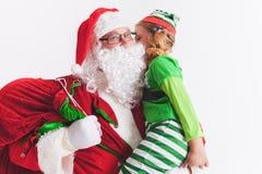 Souhait 2016 de Noël Le père noël et petite fille Dire des souhaits Image stock