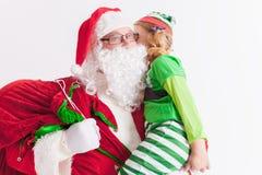 Souhait 2016 de Noël Le père noël et petite fille Dire des souhaits Images stock
