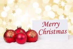 Souhaits rouges d'étoiles de carte de boules de Joyeux Noël Photographie stock libre de droits