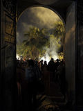 Souk El Had. People gathering during the night, just outside the Souk El Had, with palmtrees and smoke in backlight Royalty Free Stock Images