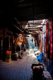 Souk in Marrakech, with sunlight streaming stock photos