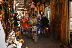 In the souk of Marrakesh Medina. A typical atmosphere at the aisles Souk in Marrakesh Medina Royalty Free Stock Image