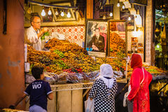 In the souk into Marrakesh Medina. A typical atmosphere at the aisles Souk in Marrakesh Medina Royalty Free Stock Images