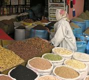 Souk shopping. Woman shopping in souk for spices in Morocco royalty free stock photos