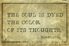 Soul is dyed Heraclitus. The soul is dyed the color of its thoughts - ancient Greek philosopher Heraclitus quote printed on grunge vintage cardboard royalty free stock photo