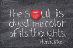 Soul is dyed Heraclitus. The soul is dyed the color of its thoughts - quote of ancient Greek philosopher Heraclitus written on chalkboard with red heart symbol royalty free stock photography