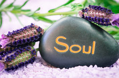 Soul lava stone. Pink sea salt, lavender flower and black lava stone with words soul Royalty Free Stock Image