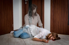 Soul leaves the body after the woman`s death. Caused by murder or accident Stock Photo