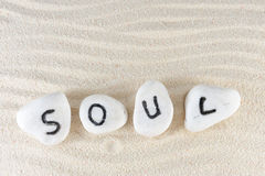 Soul word. On group of stones with sand background Royalty Free Stock Images
