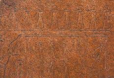 Soulagement égyptien antique d'art sur la pierre comme fond Photos libres de droits