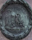 Soulagement en bronze sur un de quatre piliers entourant le piédestal de la statue équestre de l'empereur Joseph II, Josefsplatz, images libres de droits