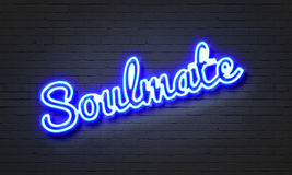 Soulmate neon sign on brick wall background. Royalty Free Stock Images