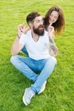 Soulmates closest people. Simple happiness. Couple in love relaxing on green lawn. Playful girlfriend and boyfriend. Dating. Couple relations goals. Couple royalty free stock photos