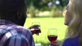 Soulmates with wineglasses discussing future plans, happy relationship, marriage. Stock footage stock video footage