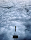 Souls Exploration. Man before mystery above clouds Royalty Free Stock Image
