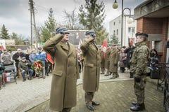 Soumission solennelle des guirlandes au monument des victimes de t Image stock