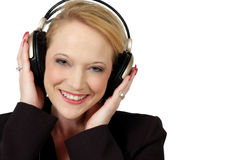 Sound. Happy woman with headphones on listening to music. Pretty blond with blue eyes Stock Photos