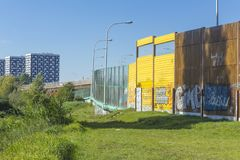 Sound absorbing screens along the highway. Metal frames filled with glass,timber and yellow sound-absorbing panels.Modern technology in Warsaw,Poland stock photos