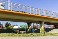 Sound absorbing screens on the highway and overpass and colored concrete pillars. Metal frames filled with glass. Modern technology in Warsaw, Poland royalty free stock images
