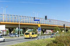 Sound absorbing screens on the highway and overpass and colored concrete pillars. Metal frames filled with glass. Modern technology in Warsaw, Poland stock images