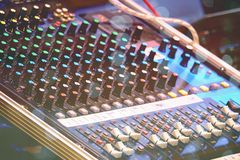 Sound and audio mixer control panel with buttons and sliders.  stock images