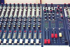 Sound and audio mixer control panel with buttons and sliders stock photo