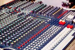 Sound and audio mixer control panel with buttons and sliders.  royalty free stock images