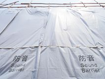 Sound Barrier Tarp or Noise Barrier in Construction SItes. Sound Barrier Tarp or Noise Barrier in construction works to reduce noise without disturbing the stock photo