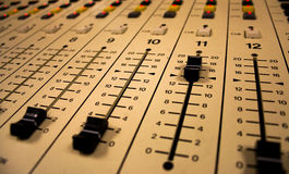 Sound Board Sliders. A radio board with all sliders set to 0, except for one Royalty Free Stock Image