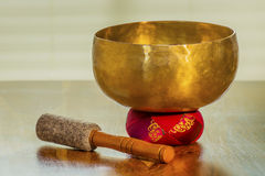 Sound bowl on a table Royalty Free Stock Images