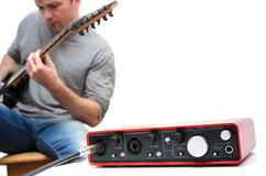 Sound card and guitarist playing music Royalty Free Stock Photography